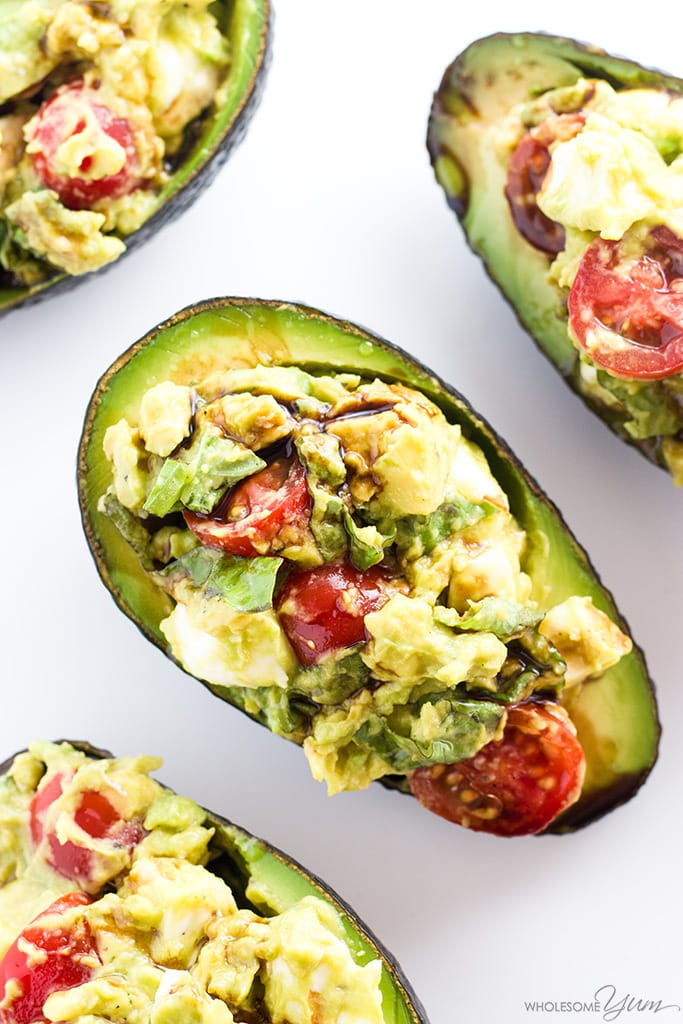 Caprese Stuffed Avocado Recipe (Low Carb, Gluten-free) - This easy Caprese stuffed avocado recipe is healthy & delicious! It's so simple to make with common ingredients you probably have right now.