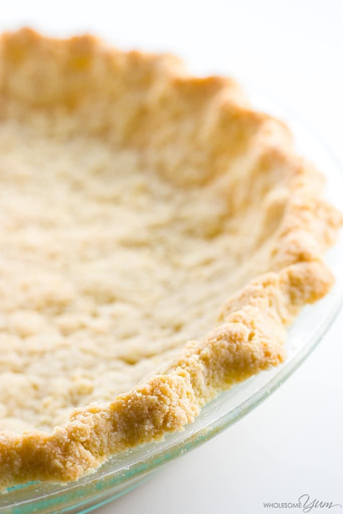 Almond Flour Pie Crust Recipe - 5 Ingredients (Paleo, Low Carb, Gluten-free) - This low carb paleo almond flour pie crust recipe is so easy to make. Just 5 minutes prep and 5 ingredients! Gluten-free, sugar-free, and keto.