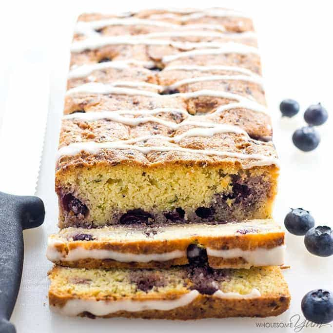 Blueberry Zucchini Bread Recipe with Lemon Glaze - This healthy lemon blueberry zucchini bread recipe is quick & easy to make with just 15 minutes prep. Low carb, gluten-free, sugar-free, and paleo.