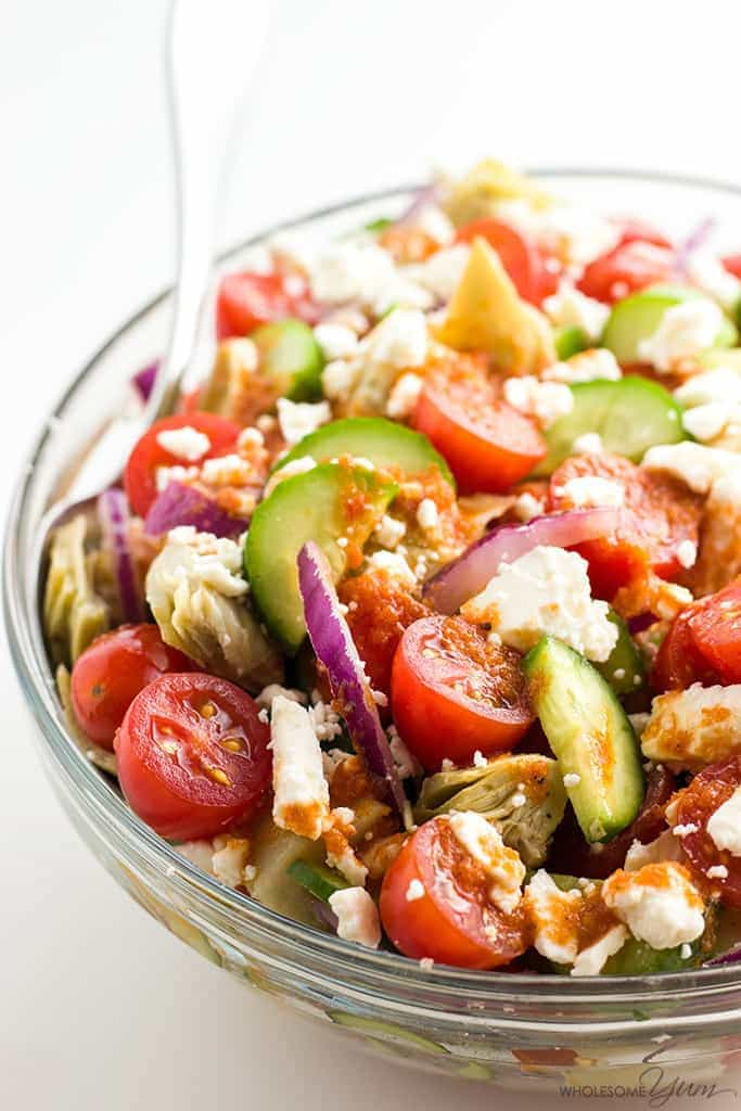 Mediterranean chopped salad in a bowl with spoon