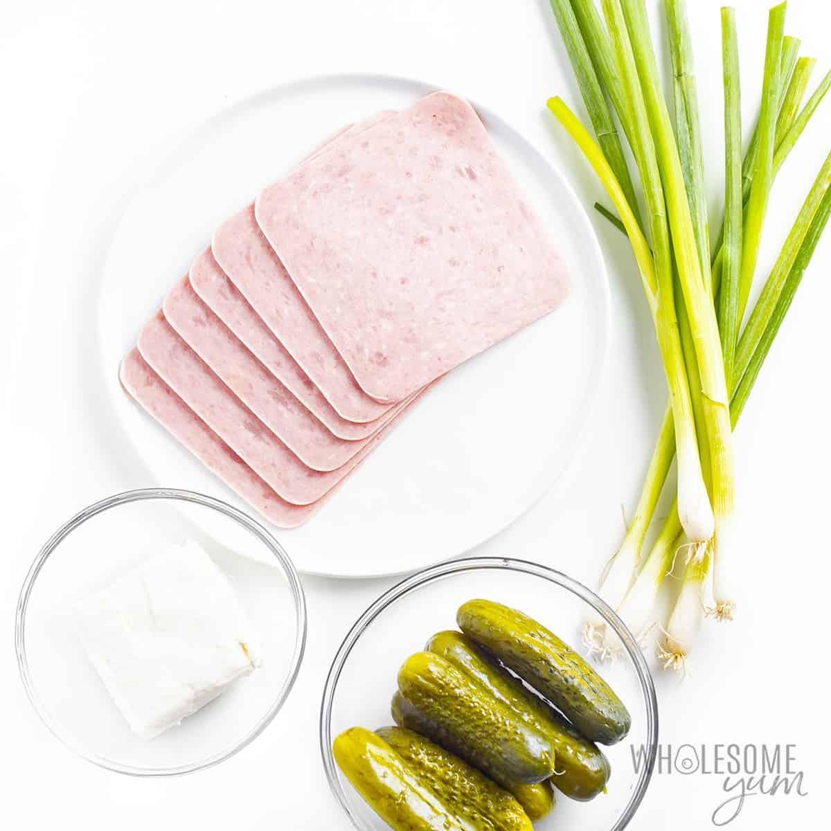 Ingredients to make pickle cream cheese and ham roll ups