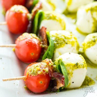 plate of Caprese salad skewers Detail: caprese-salad-skewers-with-pesto-bacon-tomato-basil-skewers-2
