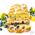 Keto blueberry zucchini bread recipe with slices spread out, blueberries, and lemon wedges