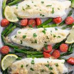 Parmesan Crusted Tilapia on a pan with vegetables
