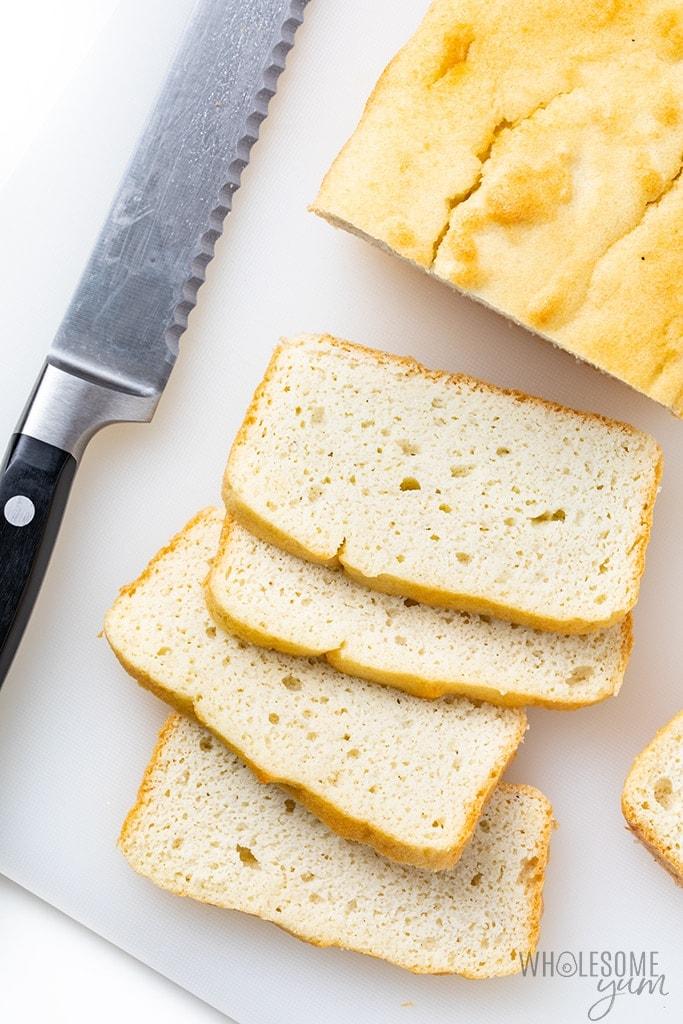 Sliced keto friendly bread on a cutting board