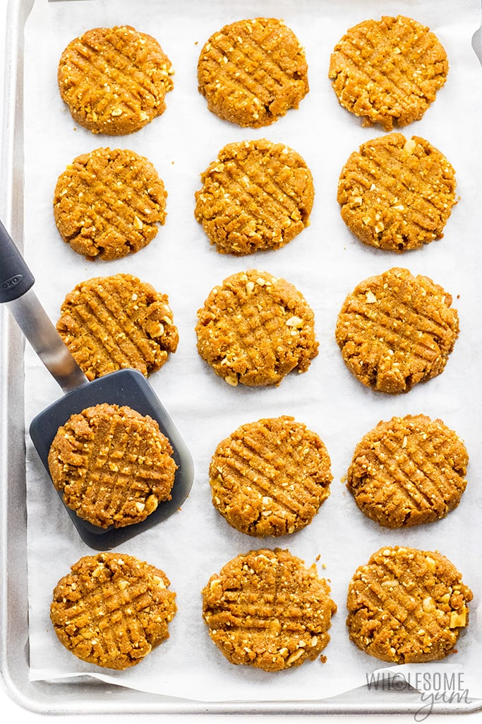 Baked sugar-free peanut butter cookies on a sheet pan