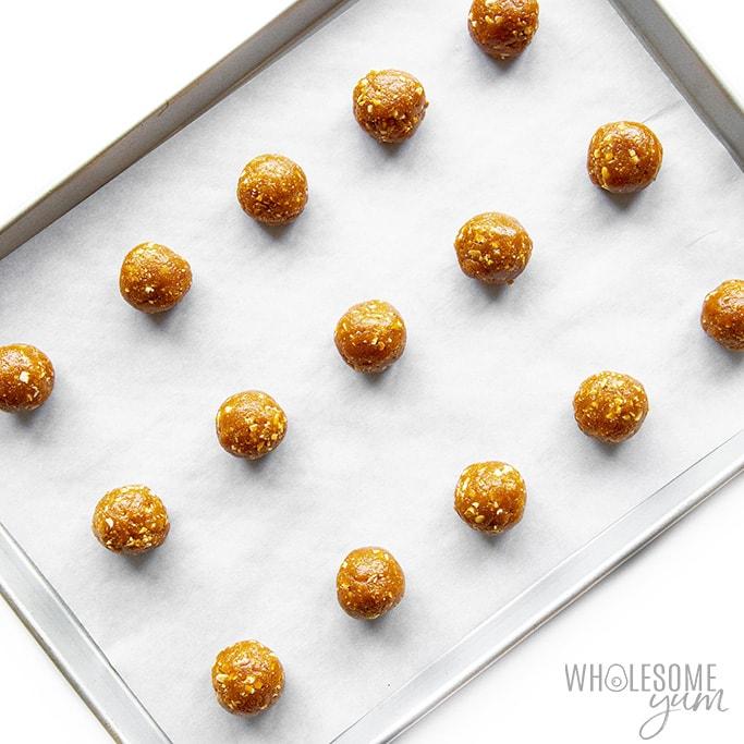 Scoops of flourless peanut butter cookies on a baking sheet
