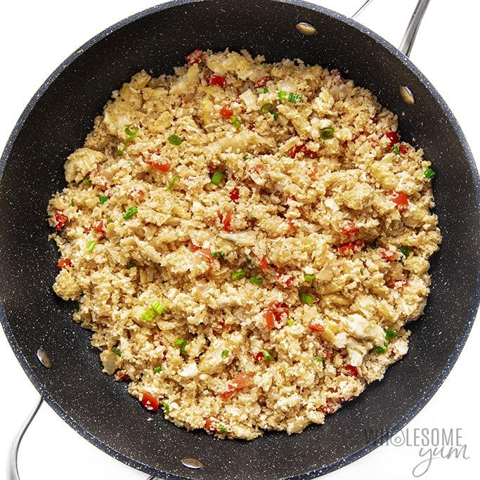 Seasoned cauliflower fried rice in frying pan