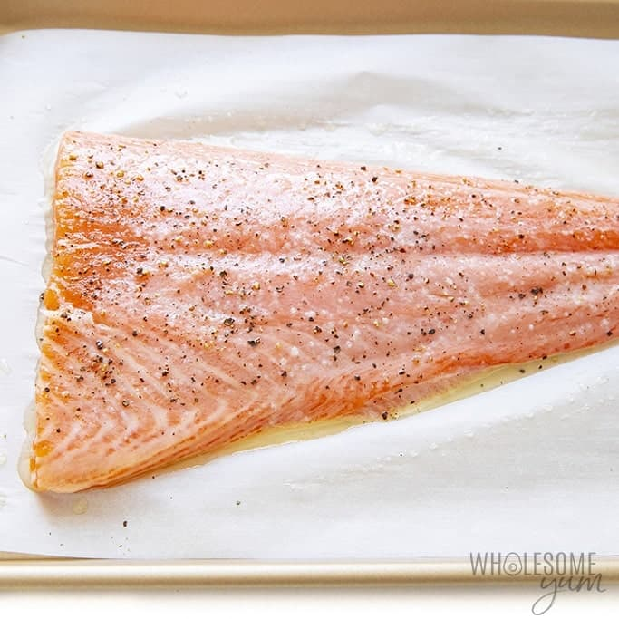 Salmon seasoned with salt and pepper
