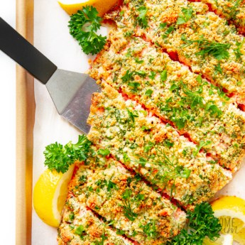 Parmesan crusted salmon with lemon wedges