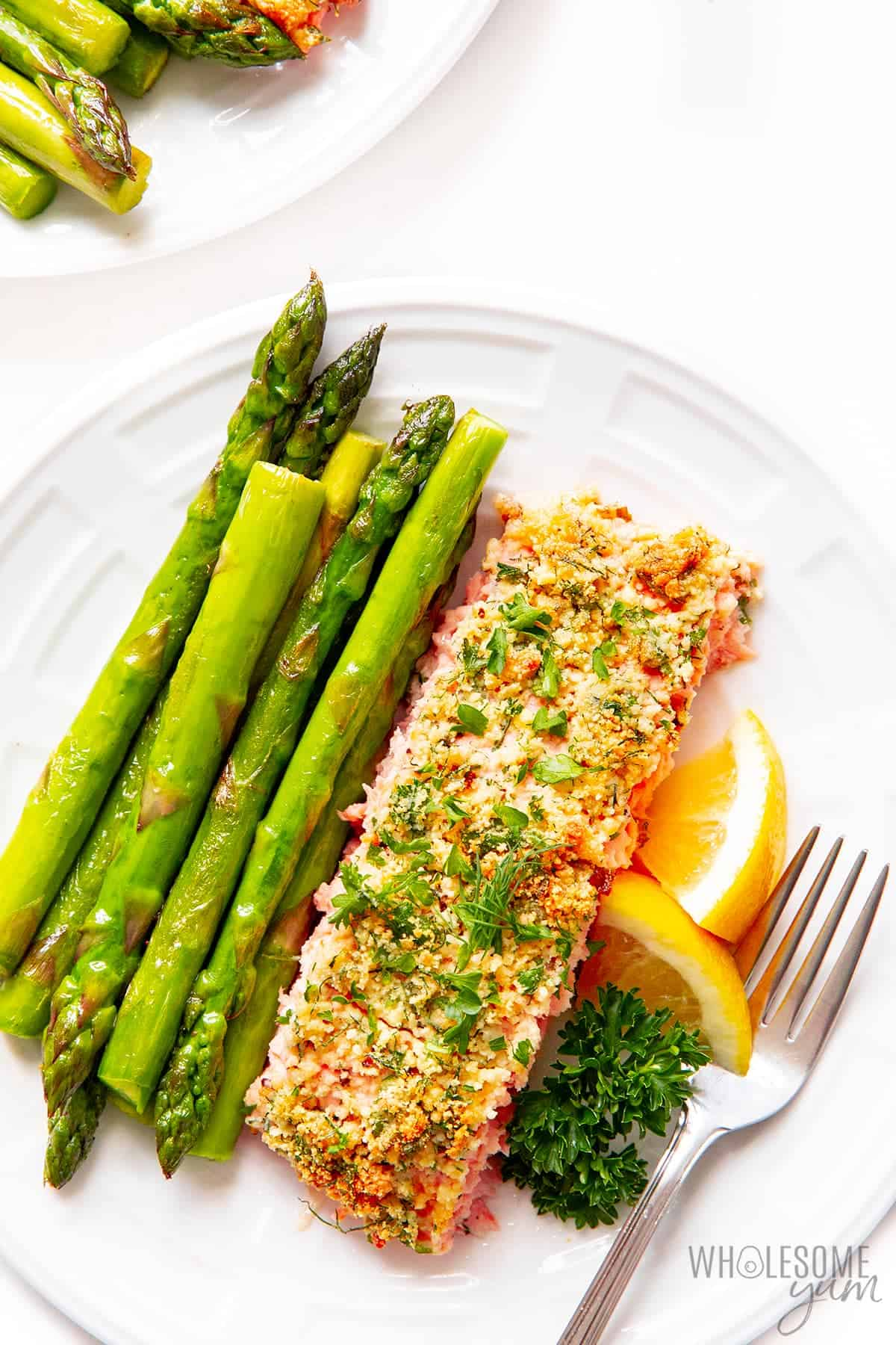Parmesan crusted salmon fillet with asparagus on a plate