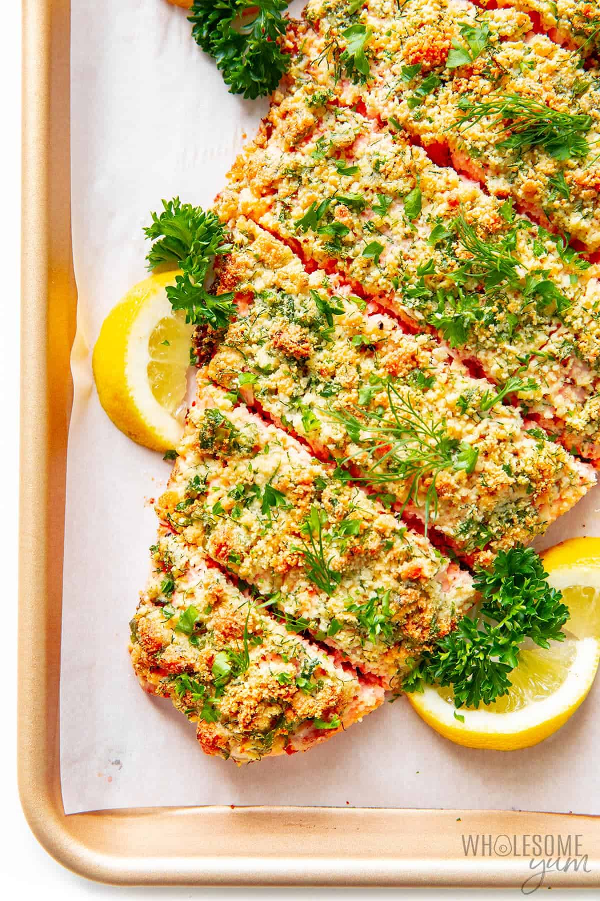 Baked parmesan crusted salmon on a baking sheet