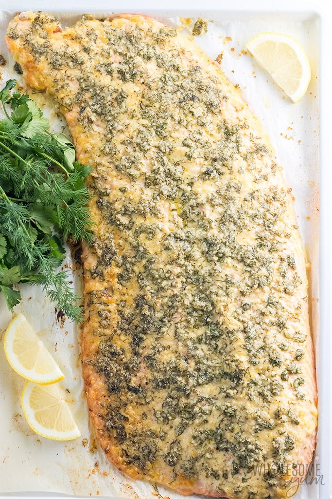 Baked Lemon Herb Parmesan Crusted Salmon Recipe - This baked lemon herb parmesan crusted salmon recipe is super easy and delicious! It's one of the best ways to make salmon. Ready in less than 30 minutes start to finish! And, it's naturally low carb, gluten-free and healthy, too.