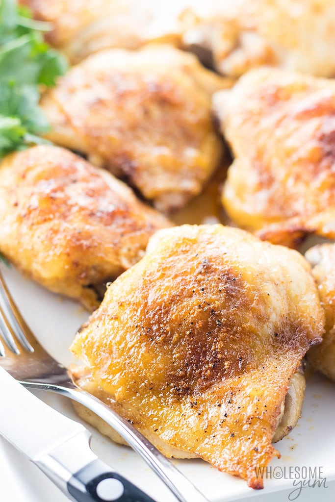 The Best, Easy Crispy Oven Baked Chicken Thighs Recipe - This easy oven baked chicken thighs recipe is simple to make at 450 degrees. Just 4 ingredients and absolutely delicious! If you want to know how to make chicken thighs crispy and tender, in LESS TIME, this is for you. And, these naturally paleo, keto chicken thighs make an easy, healthy dinner. Low carb and gluten-free.