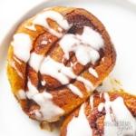 Keto fathead cinnamon rolls drizzled with icing