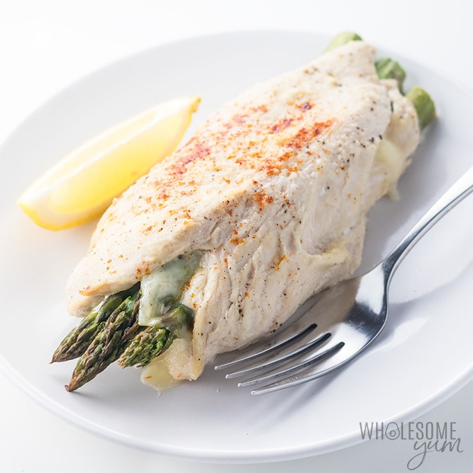 Healthy Asparagus Stuffed Chicken Breast Recipe with Provolone Cheese - Healthy asparagus stuffed chicken breast makes a quick and easy weeknight dinner! If you like easy low carb recipes that you can make in 30 minutes start to table, you need to try this asparagus stuffed chicken recipe. Gluten-free, simple, and family-friendly.