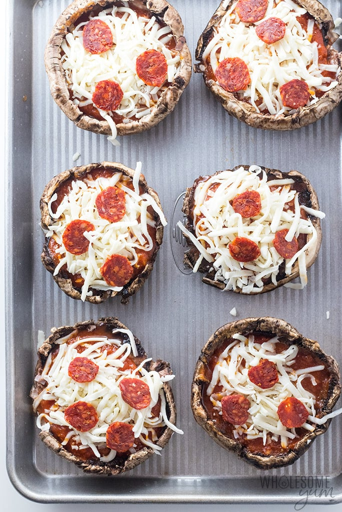 Portobello Pizza Keto Stuffed Mushrooms Recipe - Portobello pizza is an easy and delicious way to make keto stuffed mushrooms! This low carb portobello mushroom pizza recipe is quick with a few ingredients, delicious for the whole family, and Atkins friendly.