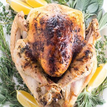Easy Garlic Butter Herb Roasted Turkey Recipe - The best garlic butter herb roasted turkey recipe ever - with tips on how to brine turkey, a chart for how long to roast turkey, how much turkey per person, and more.
