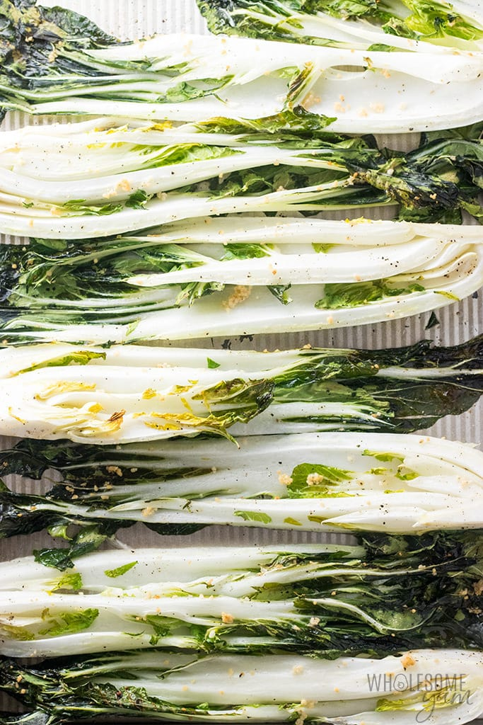 Easy Garlic Roasted Bok Choy Recipe - A super easy oven roasted bok choy recipe, made even better with roasted garlic! It makes a naturally low carb, gluten-free, keto, paleo and healthy side dish.