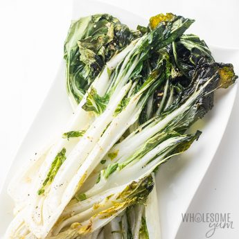 Easy Garlic Roasted Bok Choy Recipe - A super easy oven roasted bok choy recipe, made even better with roasted garlic! It makes a naturally low carb, gluten-free, keto, paleo and healthy side dish. Detail: easy-garlic-roasted-bok-choy-recipe-3