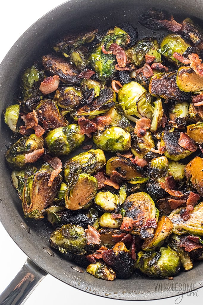 Crispy Pan Fried Brussel Sprouts Recipe with Bacon and Balsamic Vinegar - Ready in under 30 minutes with 4 ingredients, this crispy fried brussel sprouts recipe is the best of both worlds! The perfect combo of pan fried brussel sprouts with bacon AND pan fried brussel sprouts with balsamic vinegar.