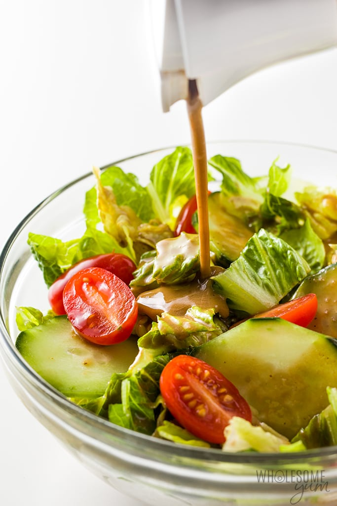 Creamy Balsamic Dressing Recipe - Pouring dressing over salad