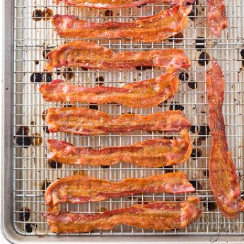How To Cook Bacon In The Oven - Oven baked bacon on rack, square image