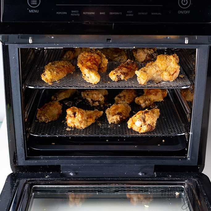 Crispy Air Fryer Chicken Wings Recipe - Shown on two racks in the air fryer oven