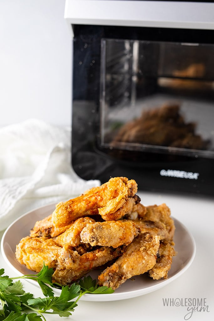 Crispy Air Fryer Chicken Wings Recipe - Side view in front of air fryer