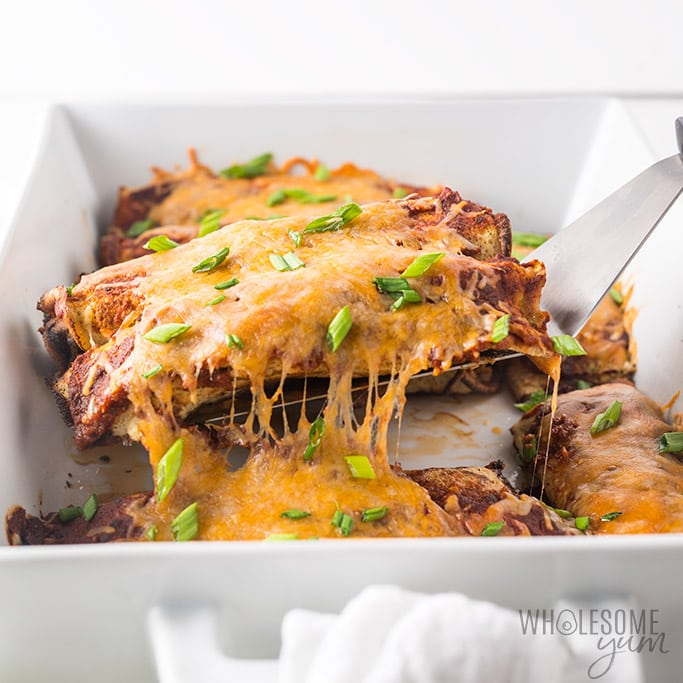 Low Carb Enchiladas Recipe - Cheese pull photo, taking the enchiladas out of the pan