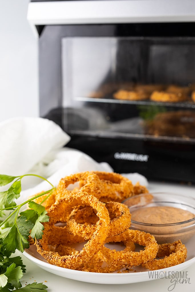 Air Fryer Keto Onion Rings Recipe - onion rings in front of air fryer