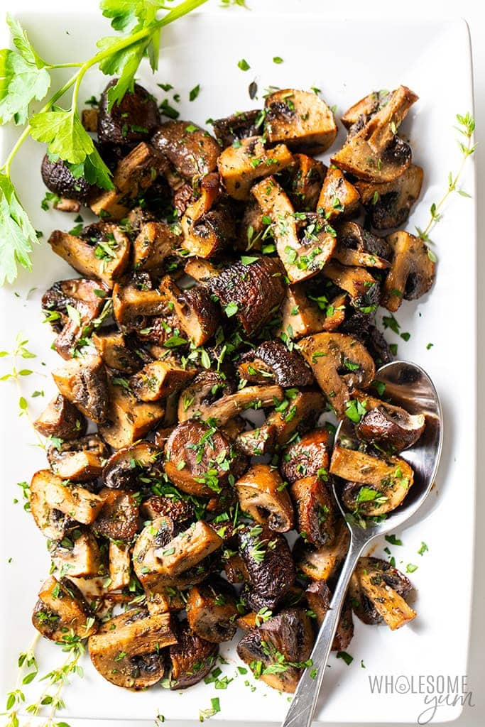 balsamic roasted mushrooms on white serving platter