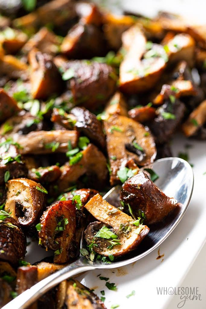 oven roasted mushrooms close up with spoon