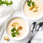 two bowls of healthy roasted cauliflower soup