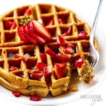 Protein waffle recipe shown with strawberries and a fork