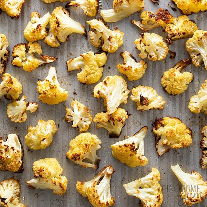 roasted cauliflower on a pan for paleo hummus