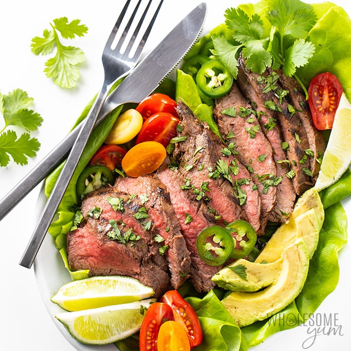 Sliced carne asada on plate