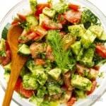 Cucumber tomato avocado salad in a bowl