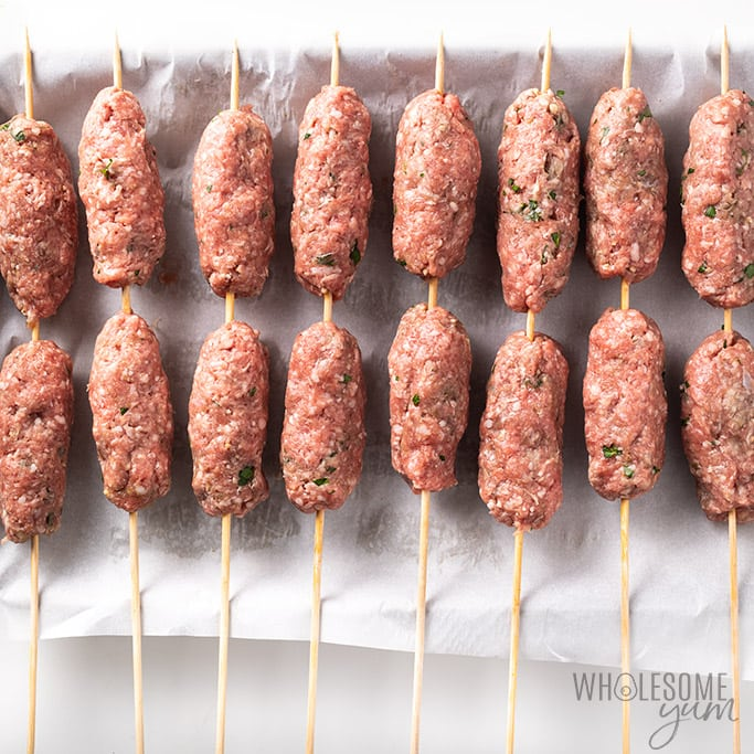 Lamb kofta kebabs on skewers - raw before cooking