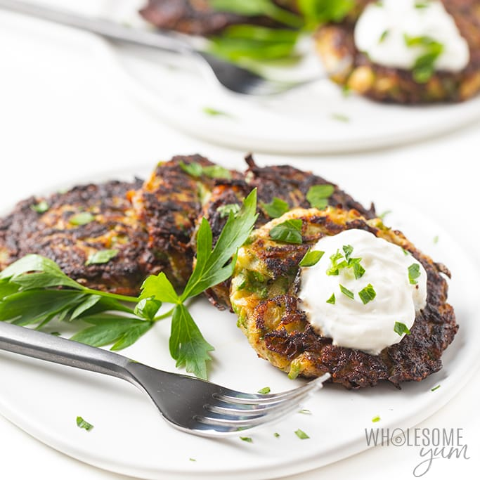 plate of low carb zucchini fritters with sour cream