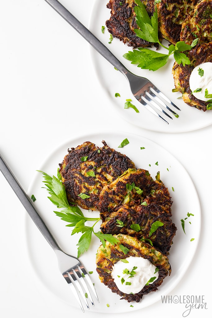 zucchini fritters recipe on plates with parsley
