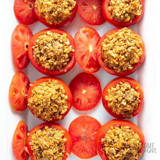 Greek stuffed tomatoes in a baking pan