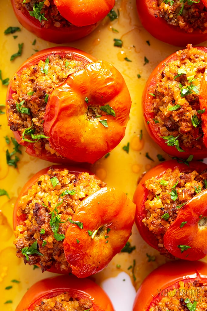 two rows of meat stuffed tomatoes