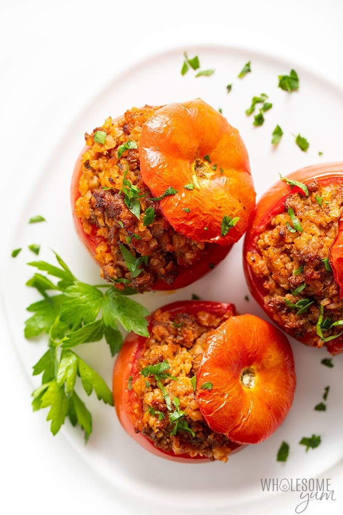 finished stuffed tomato recipe on a plate with parsley