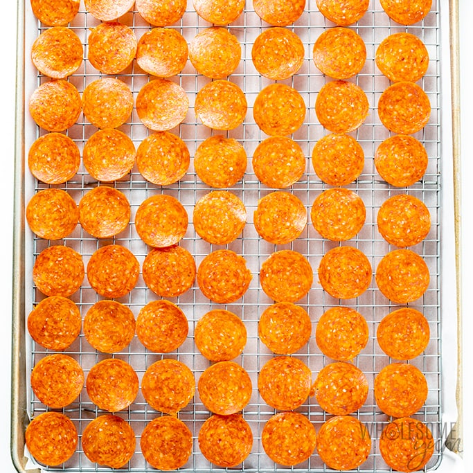 how to make pepperoni chips - pepperoni arranged on a cooling rack