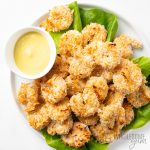 healthy coconut shrimp on a platter with dipping sauce
