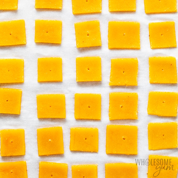cheddar cheese crackers on a baking sheet