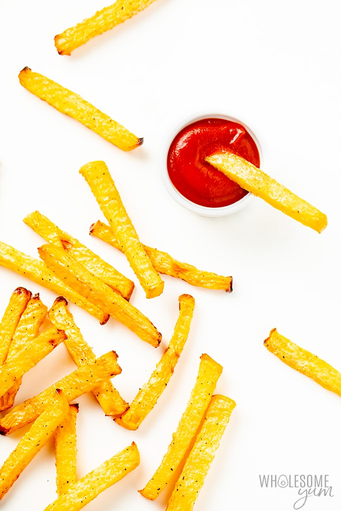 rutabaga fries dipped in ketchup