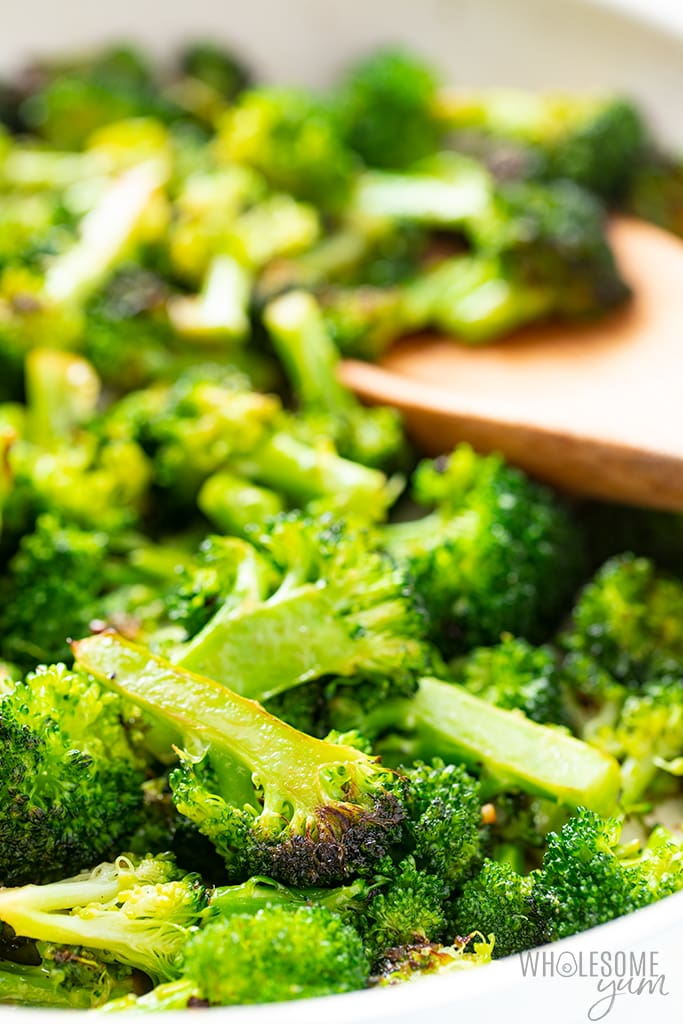 broccoli stir fry with wooden spoon