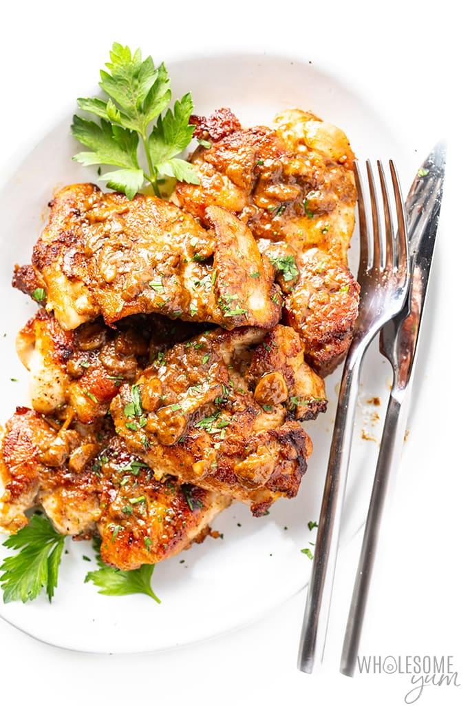 garlic butter chicken thighs on a platter